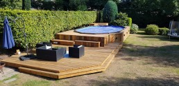 Bespoke rustic, decked swimming pool area